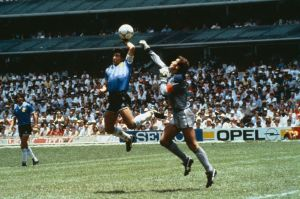 Argentina's Diego Maradona scores their first goal with his hand over Peter Shilton of England-1753130